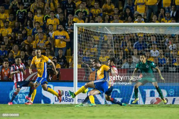 Andre Gignac of Tigres scores his team's first goal during the Final first leg match between Tigres UANL and Chivas as part of the Torneo Clausura...