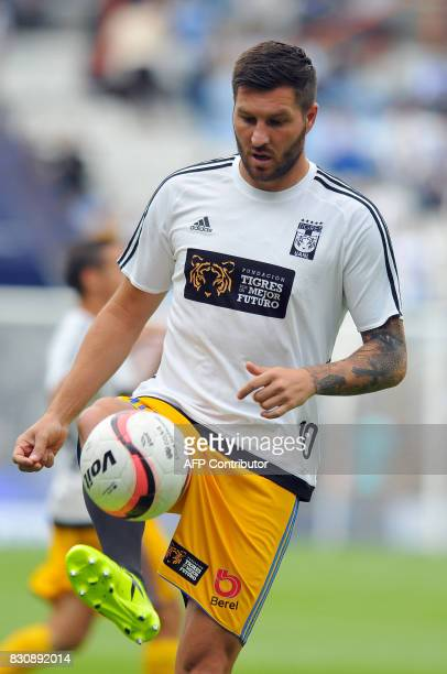 Andre Gignac of Tigres warms up before the start of their Mexican Apertura 2017 Tournament football match against Pachuca at Hidalgo stadium on...