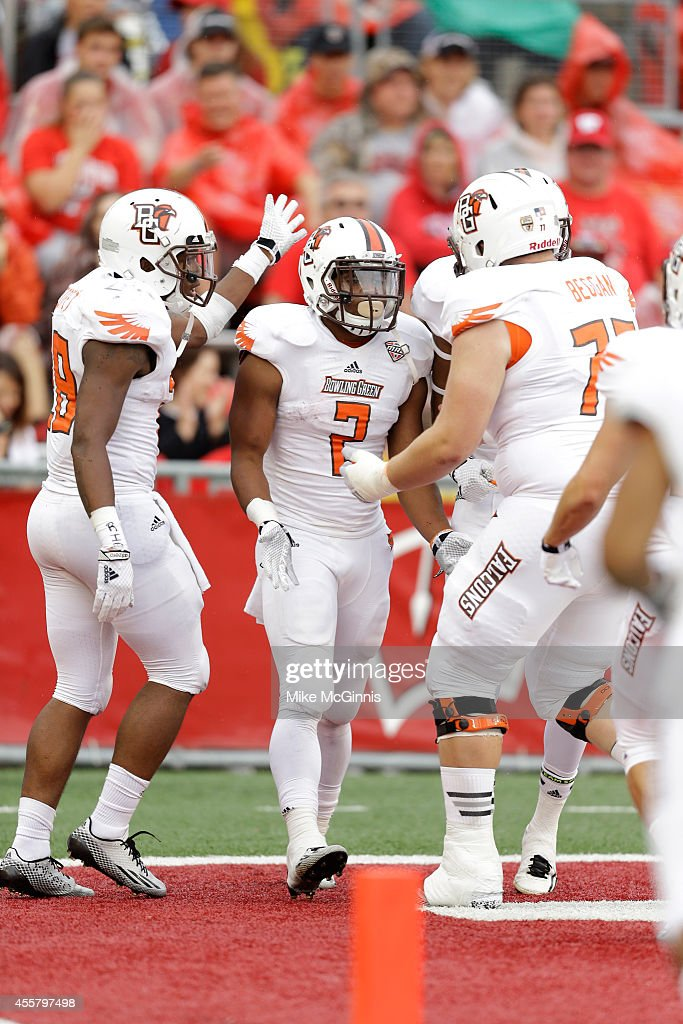 Andre Givens of the Bowling Green Falcons celebrates after scoring a touchdown during the fourth quarter against the Wisconsin Badgers at Camp...