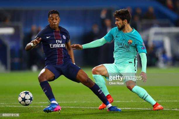 Andre Gomes of Barcelona battles for the ball with Presnel Kimpembe of Paris SaintGermain during the UEFA Champions League Round of 16 first leg...