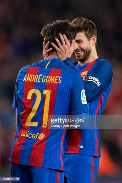 Andre Gomes of Barcelona celebrates scoring his team's fourth goal with his teammate Gerard Pique during the La Liga match between FC Barcelona and...