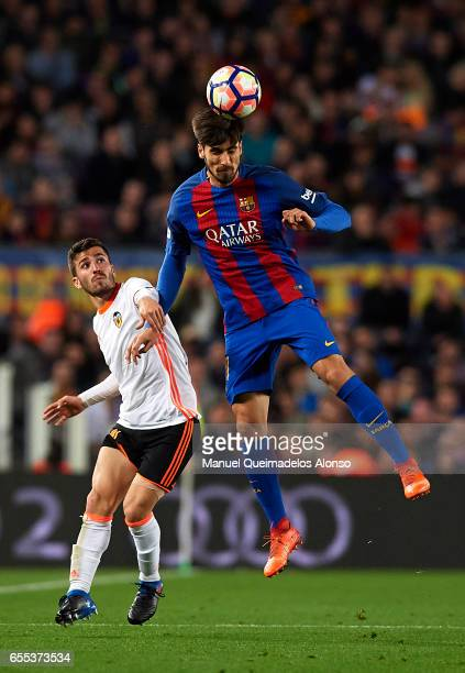 Andre Gomes of Barcelona competes for the ball with Jose Luis Gaya of Valencia during the La Liga match between FC Barcelona and Valencia CF at Camp...