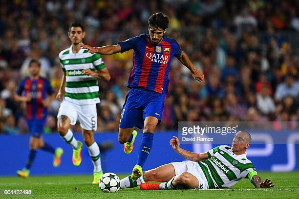 Andre Gomes of Barcelona skips over a challenge from Scott Brown of Celtic during the UEFA Champions League Group C match between FC Barcelona and...