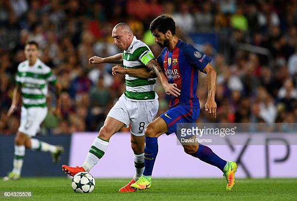Andre Gomes of Barcelons tackles Scott Brown of Celtic during the UEFA Champions League Group C match between FC Barcelona and Celtic FC at Camp Nou...