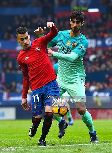Andre Gomes of FC Barcelona competes for the ball with Alex Berenguer of CA Osasuna during the La Liga match between CA Osasuna and FC Barcelona at...