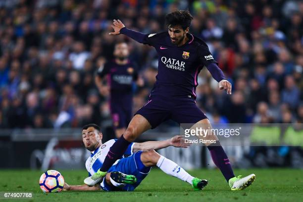 Andre Gomes of FC Barcelona competes for the ball with Javi Fuego of RCD Espanyol during the La Liga match between RCD Espanyol and FC Barcelona at...