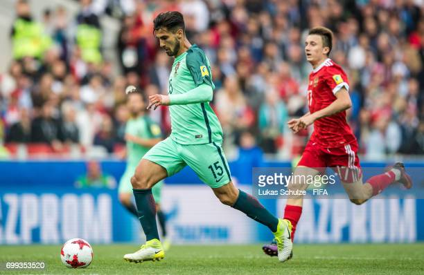Andre Gomes of Portugal and Aleksandr Golovin of Russia fight for the ball during the FIFA Confederations Cup Russia 2017 Group A match between...