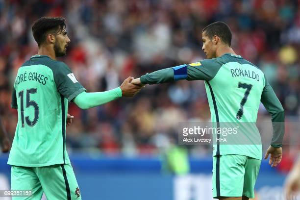 Andre Gomes of Portugal and Cristiano Ronaldo of Portugal celerbate togther after the FIFA Confederations Cup Russia 2017 Group A match between...