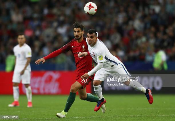 Andre Gomes of Portugal and Gary Medel of Chile battle for possession during the FIFA Confederations Cup Russia 2017 SemiFinal between Portugal and...
