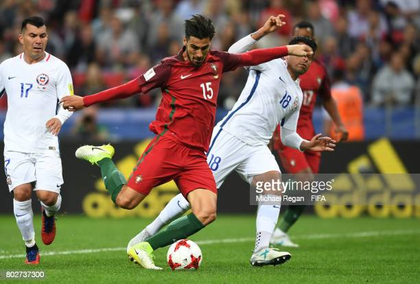 Andre Gomes of Portugal attempts to shoot while under pressure from Gonzalo Jara of Chile during the FIFA Confederations Cup Russia 2017 SemiFinal...