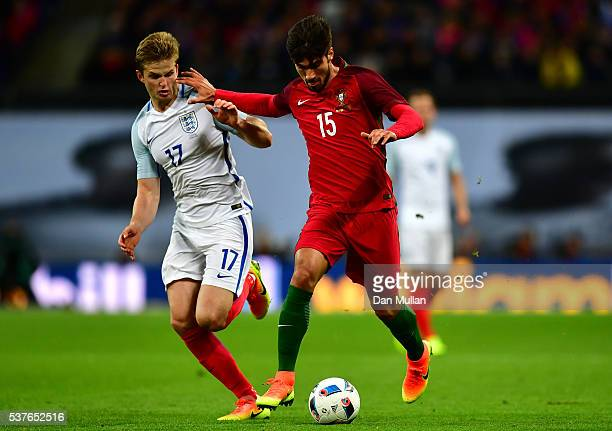 Andre Gomes of Portugal holds off Eric Dier of England during the international friendly match between England and Portugal at Wembley Stadium on...