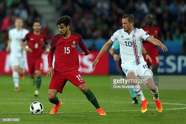 Andre Gomes of Portugal in action with Gylfi Sigurdsson of Iceland during the UEFA Euro 2016 Group F match between Portugal and Iceland at Stade...