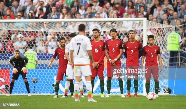 Andre Gomes of Portugal Jose Fonte of Portugal Cristiano Ronaldo of Portugal and Raphael Guerreiro of Portugal form a wall as Miguel Layun of Mexico...