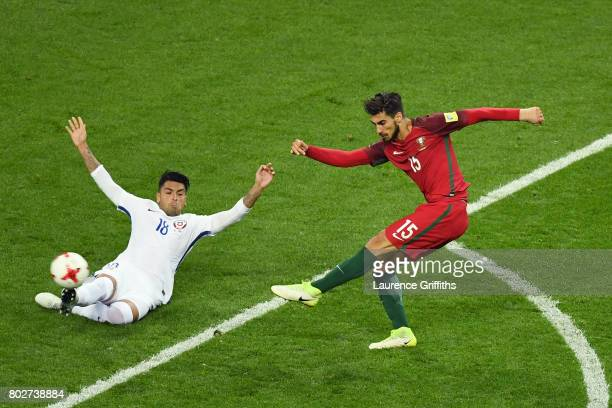 Andre Gomes of Portugal shoots as Gonzalo Jara of Chile attempts to block during the FIFA Confederations Cup Russia 2017 SemiFinal between Portugal...
