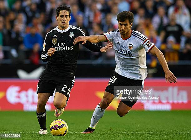 Andre Gomes of Valencia competes for the ball with Isco of Real Madrid during the La Liga match between Valencia CF and Real Madrid CF at Estadi de...