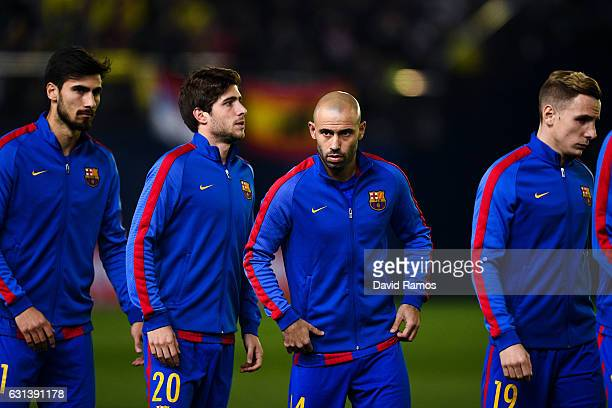 Andre Gomes Sergi Roberto Javier Mascherano and Lucas Digne of FC Barcelona look on prior to the kickoff of the La Liga match between Villarreal CF...