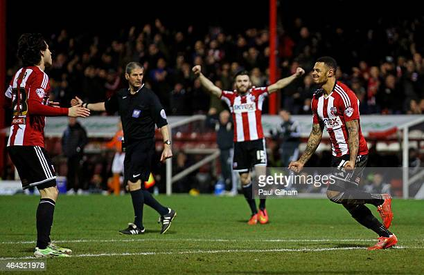 Andre Gray of Brentford celebrates after scoring his team's third goal during the Sky Bet Championship match between Brentford and Blackpool at...