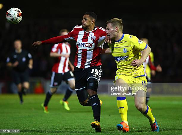 Andre Gray of Brentford holds off Sheffield Wednesdays Tom Lees during the Sky Bet Championship match between Brentford and Sheffield Wednesday at...