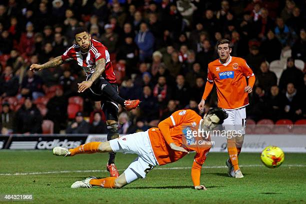 Andre Gray of Brentford scores his team's third goal during the Sky Bet Championship match between Brentford and Blackpool at Griffin Park on...