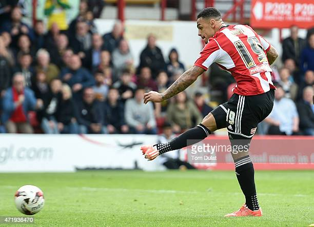 Andre Gray of Brentford scores his team's third goal during the Sky Bet Championship match between Brentford and Wigan Athletic at Griffin Park on...