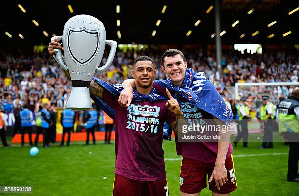 Andre Gray of Burnley and Michael Keane of Burnley celebrate winning the Championship after the Sky Bet Championship between Charlton Athletic and...
