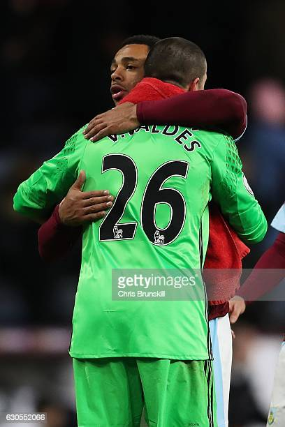 Andre Gray of Burnley and Victor Valdes of Middlesbrough embrace following the Barclays Premier League match between Burnley and Middlesbrough on...