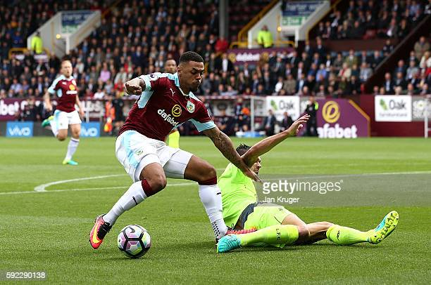 Andre Gray of Burnley battles with Dejan Lovren of Liverpool during the Premier League match between Burnley and Liverpool at Turf Moor on August 20...