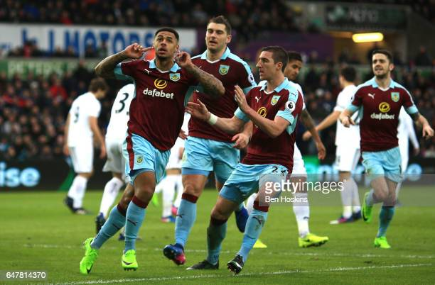 Andre Gray of Burnley celebrates scoring his sides first goal with his Burnley team mates during the Premier League match between Swansea City and...
