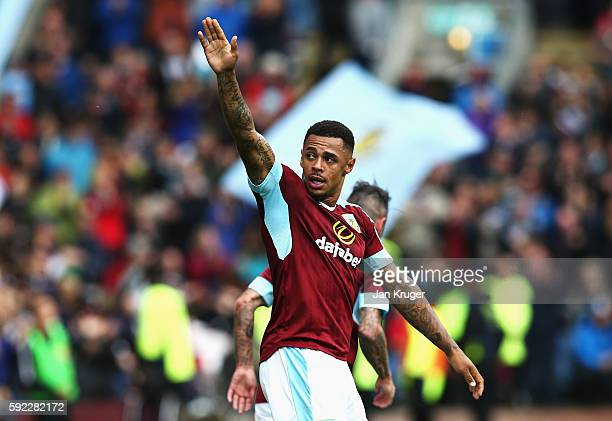 Andre Gray of Burnley celebrates scoring his sides second goal during the Premier League match between Burnley and Liverpool at Turf Moor on August...