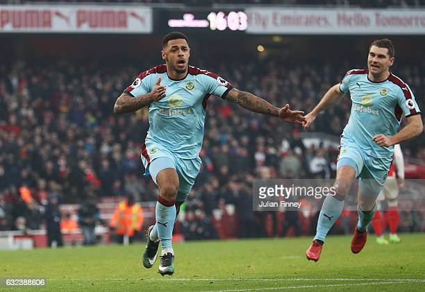Andre Gray of Burnley celebrates scoring his team's first goal from the penalty spot during the Premier League match between Arsenal and Burnley at...