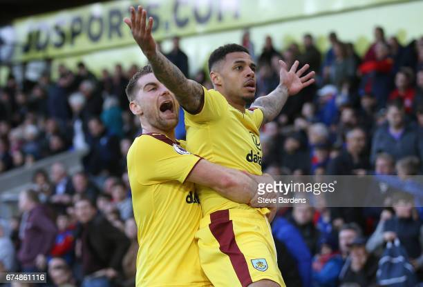 Andre Gray of Burnley celebrates scoring his team's second goal with Sam Vokes during the Premier League match between Crystal Palace and Burnley at...