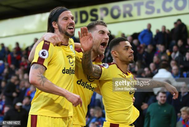 Andre Gray of Burnley celebrates scoring his team's second goal with Sam Vokes and George Boyd during the Premier League match between Crystal Palace...
