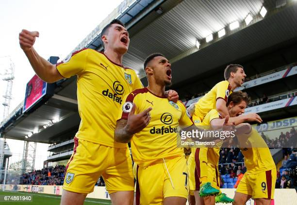 Andre Gray of Burnley celebrates scoring his team's second goal with Michael Keane during the Premier League match between Crystal Palace and Burnley...