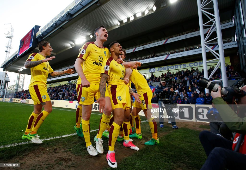 Andre Gray of Burnley celebrates scoring his team's second goal with Michael Keane during the Premier League match between Crystal Palace and Burnley at Selhurst Park on April 29, 2017 in London, England.