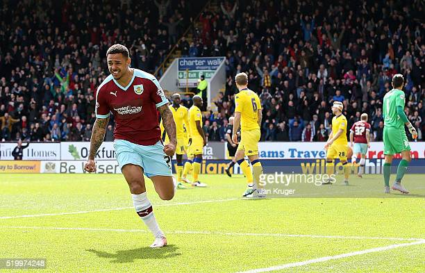 Andre Gray of Burnley celebrates the opening goal by Scott Arfield of Burnley during the Sky Bet Championship match between Burnley and Leeds United...
