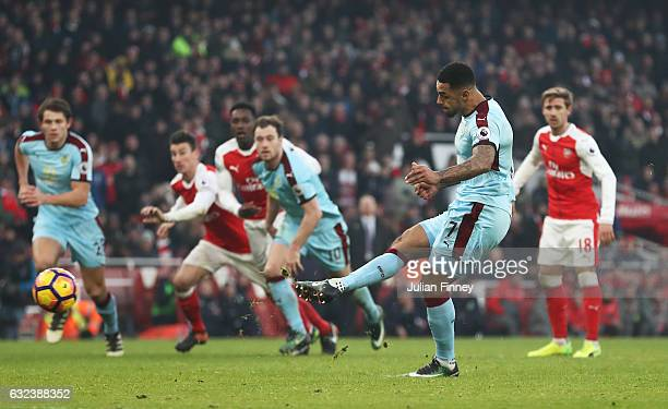Andre Gray of Burnley converts the penalty to score his side's first goal to make it 11 during the Premier League match between Arsenal and Burnley...