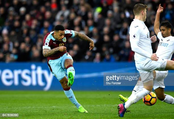 Andre Gray of Burnley scores his sides second goal during the Premier League match between Swansea City and Burnley at Liberty Stadium on March 4...