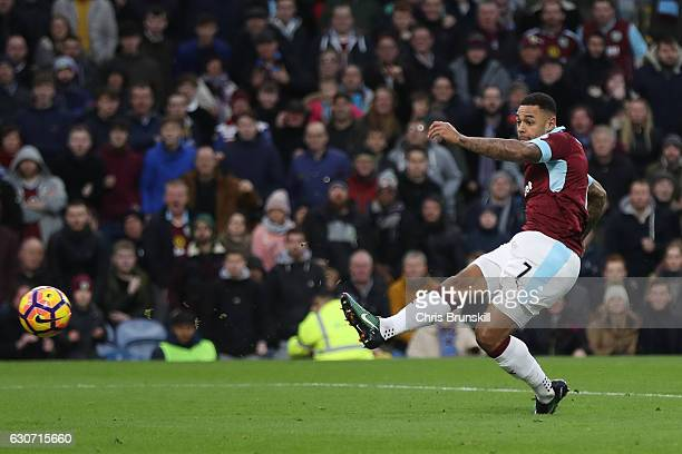 Andre Gray of Burnley scores the opening goal during the Premier League match between Burnley and Sunderland at Turf Moor on December 31 2016 in...