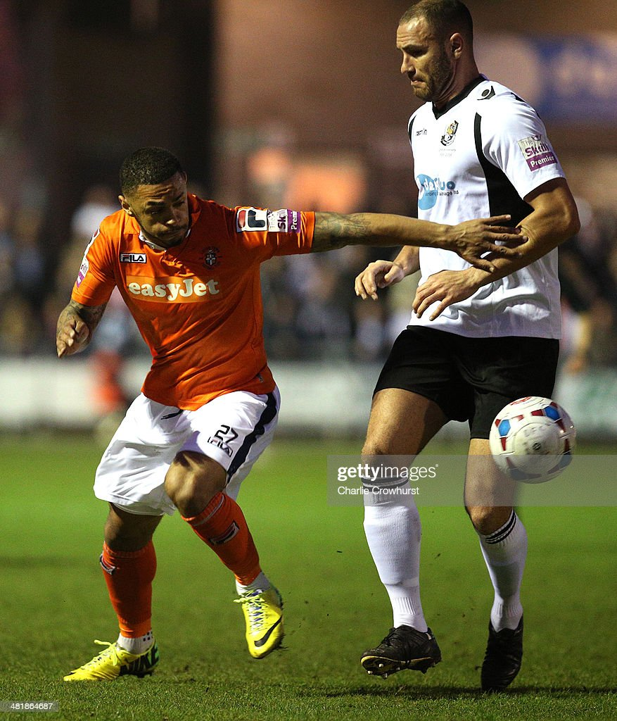 <a gi-track='captionPersonalityLinkClicked' href=/galleries/search?phrase=Andre+Gray&family=editorial&specificpeople=12891824 ng-click='$event.stopPropagation()'>Andre Gray</a> of Luton looks to break clear of Dartford defender Mat Mitchel-King during the Skrill Conference Premier match between Dartford and Luton Town at Princes Park on April 01, 2014 in Dartford, England,