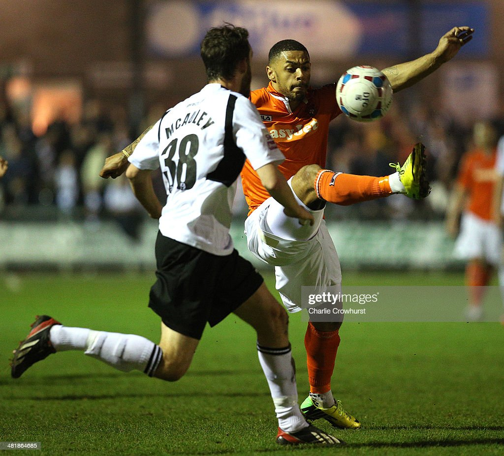 <a gi-track='captionPersonalityLinkClicked' href=/galleries/search?phrase=Andre+Gray&family=editorial&specificpeople=12891824 ng-click='$event.stopPropagation()'>Andre Gray</a> of Luton looks to chip the ball over Dartford defender Rory McAuley during the Skrill Conference Premier match between Dartford and Luton Town at Princes Park on April 01, 2014 in Dartford, England,
