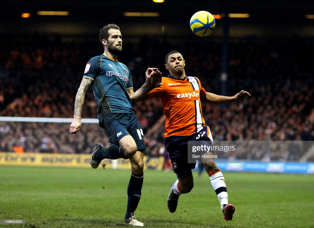 <a gi-track='captionPersonalityLinkClicked' href=/galleries/search?phrase=Andre+Gray&family=editorial&specificpeople=12891824 ng-click='$event.stopPropagation()'>Andre Gray</a> of Luton puts Roger Johnson of Wolves under pressure during the FA Cup with Budweiser Third Round match between Luton Town and Wolverhampton Wanderers at Kenilworth Road on January 5, 2013 in Luton, England.