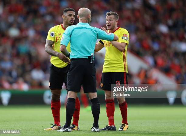 Andre Gray of Watford and Tom Cleverley of Watford argue with referee Roger East during the Premier League match between AFC Bournemouth and Watford...