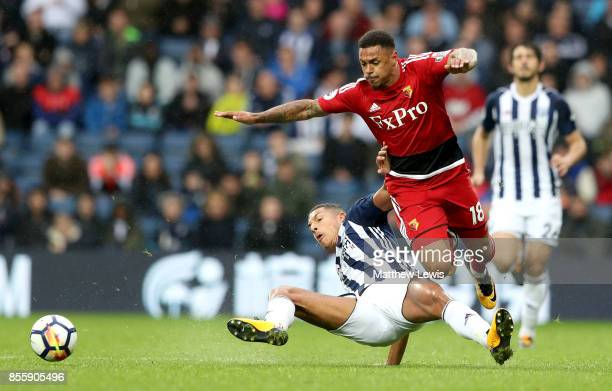 Andre Gray of Watford is tackled by Jake Livermore of West Bromwich Albion compete for the ball during the Premier League match between West Bromwich...