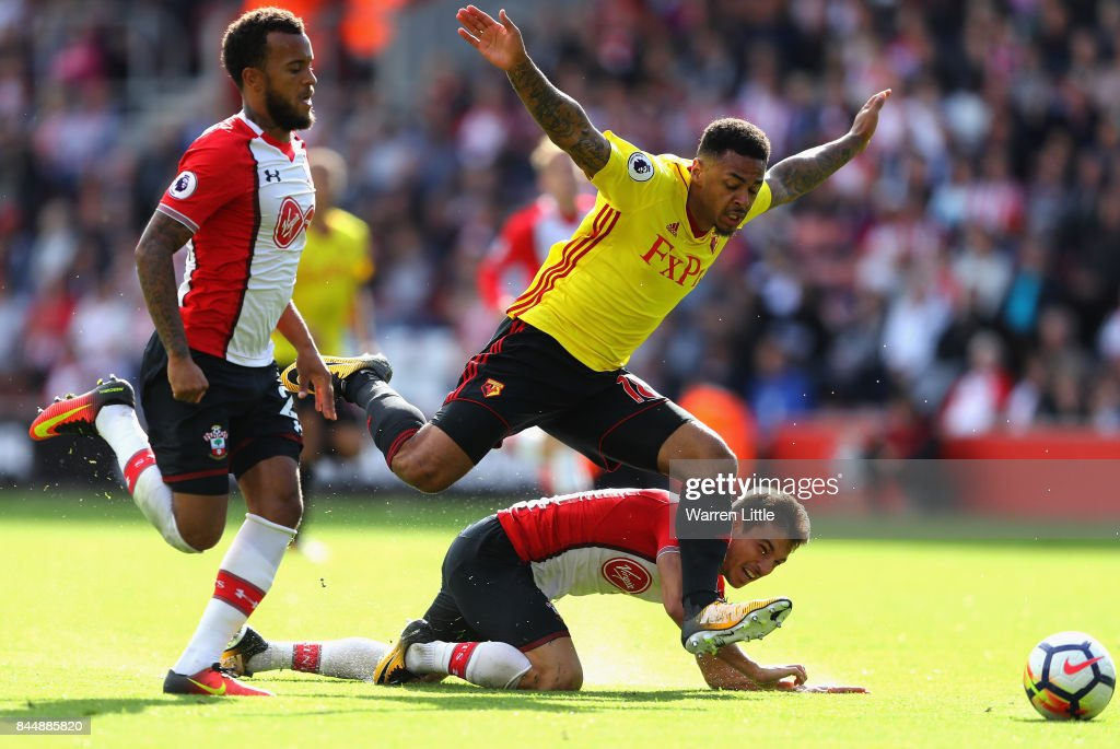 Andre Gray of Watford takes on Cedric Soares and Ryan Bertrand of Southampton in action during the Premier League match between Southampton and Watford at St Mary's Stadium on September 9, 2017 in Southampton, England.