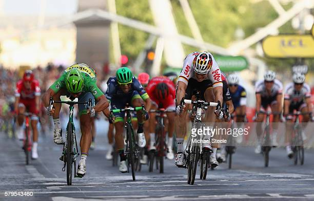 Andre Greipel of Germany and LottoSoudal beats Peter Sagan of Slovakia and Tinkoff as he crosses the finish line to win stage twenty one of the 2016...