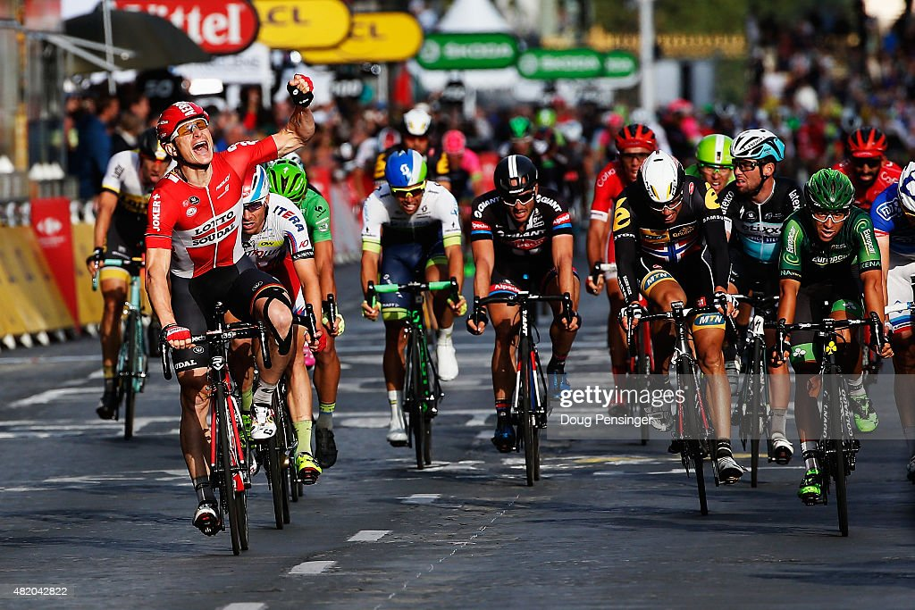 Andre Greipel (L) of Germany and Lotto-Soudal celebrates as he crosses the finish line to win the twenty first stage of the 2015 Tour de France, a 109.5 km stage between Sevres and Paris Champs-Elysees, on July 26, 2015 in Paris, France.