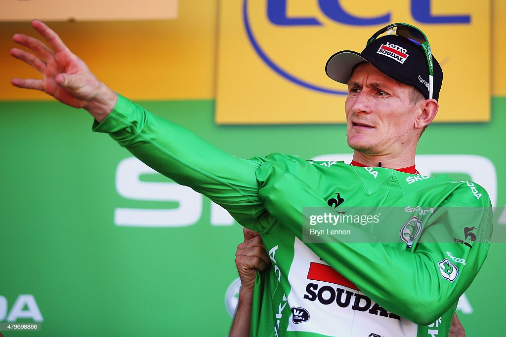 <a gi-track='captionPersonalityLinkClicked' href=/galleries/search?phrase=Andre+Greipel&family=editorial&specificpeople=874849 ng-click='$event.stopPropagation()'>Andre Greipel</a> of Germany and Lotto-Soudal celebrates as he is awarded the green jersey on the podium after stage three of the 2015 Tour de France, a 159.5 km stage between Anvers and Huy, on July 6, 2015 in Huy, Belgium.