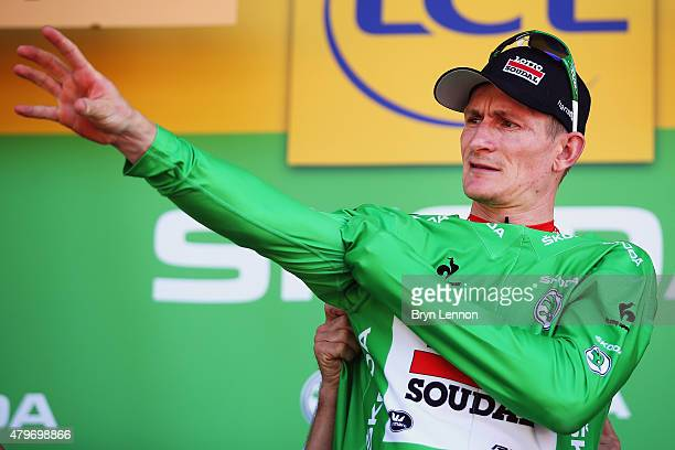 Andre Greipel of Germany and LottoSoudal celebrates as he is awarded the green jersey on the podium after stage three of the 2015 Tour de France a...