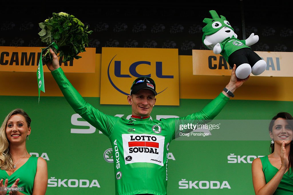 Andre Greipel of Germany and Lotto-Soudal celebrates as he is awarded the green jersey on the podium after stage four of the 2015 Tour de France, a 223.5km stage between Seraing and Cambrai, on July 7, 2015 in Cambrai, France.