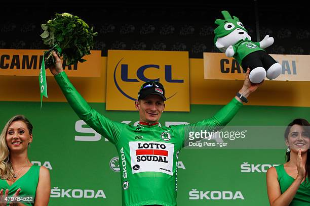 Andre Greipel of Germany and LottoSoudal celebrates as he is awarded the green jersey on the podium after stage four of the 2015 Tour de France a...